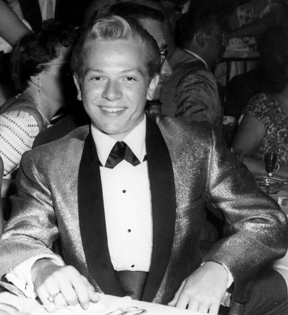 Feeling sophisticated in my gold lamé tuxedo jacket at a grad night event in 1958, a few days after my 15th birthday.